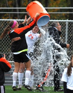 Senior Captains Emma Kate Womack and Rae Reed douse head coach Vince Pimpinella after beating Kiski and clinching the playoffs for the first time in 21 years.