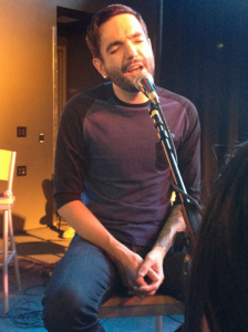 Jeremy McKinnon of A Day to Remember singing at the VIP acoustic show. Photo taken by Emily Porter.