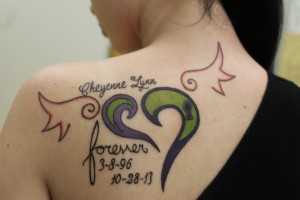 """""""I got my first tattoo for my best friend Cheyenne Uncapher. I got a heart with wings because it was something that Chey would draw a lot and because this is actually one of her drawings. The design and color scheme was all her! I didn't change a thing. Cheyenne got the word 'forever' on her wrist and I had it incorporated into my tattoo to resemble that she will forever be by my side and always be my friend."""""""