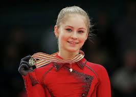 Julia Lipniskaia showing her medal off.
