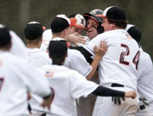 Team mobs Freshman Jared Kollar after he gets the game winning hit against #1 Penn Trafford.