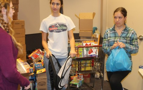 Interact Club officers and members pack backpacks for charity