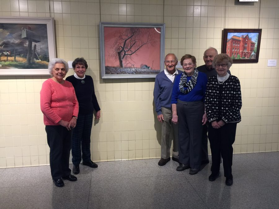 Teresa Gaudino, Barbara Nakles (GLSD Art Conservation Trust Chair), Chick Cicconi, Eleanor Cicconi, Boo McHenry, Shirley Robb (Left to Right), Pictured here standing next to the painting Light Snow by Roy Hilton. They are members of the class 1948 and  came to tour the school and see the paintings they had purchased. There was actually five paintings purchased in this year.