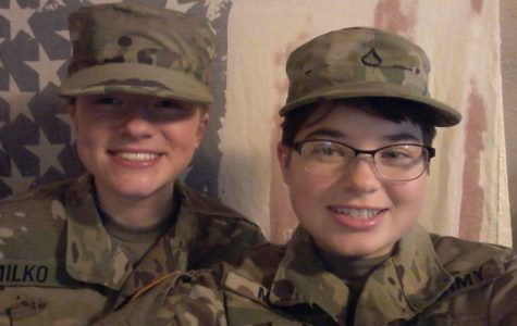 Annika Milko and her sister Michaela Milko pose for a picture in their National Guard Uniforms.