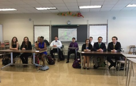 Law Students sit in mock trial court to have their cases heard.