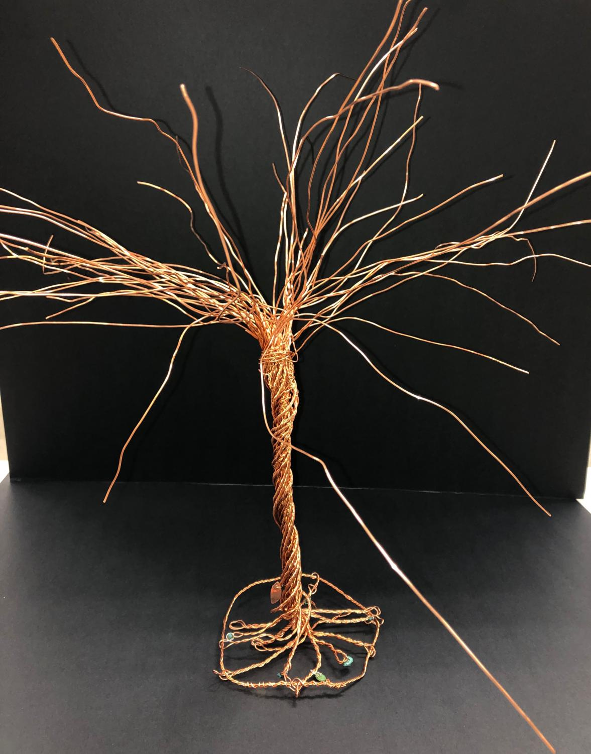 A tree made from copper wire crafted by Izzy Miller.