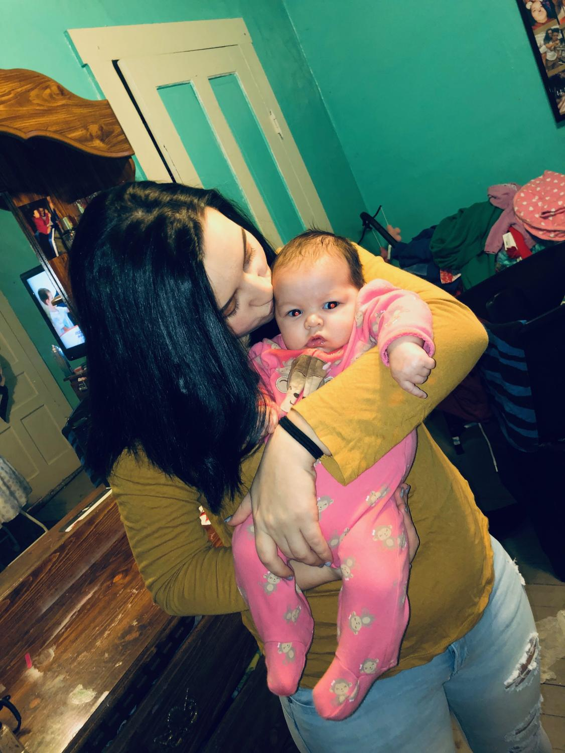 Greater Latrobe High School senior Cortnie Plows bonds with three month old daughter Lilly.