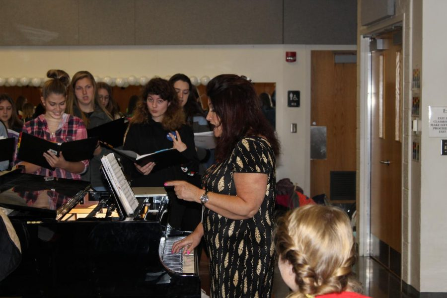 Ms. Baltzer is working with the Women's Choir on their parts in preparation for the Winter Concert.