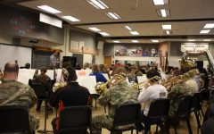 Members of the 28th Infantry Division Band perform alongside Greater Latrobe Senior High band students.