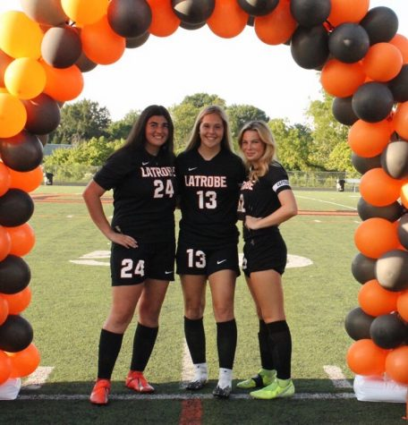 Sanova Henschel, Maddie Delucio, and Hannah Klimek, all senior captains of the girls latrobe soccer team, enjoy their senior night together. The girls started and ended the night off with celebration as the beat their Mount Pleasant opponents 4-1.