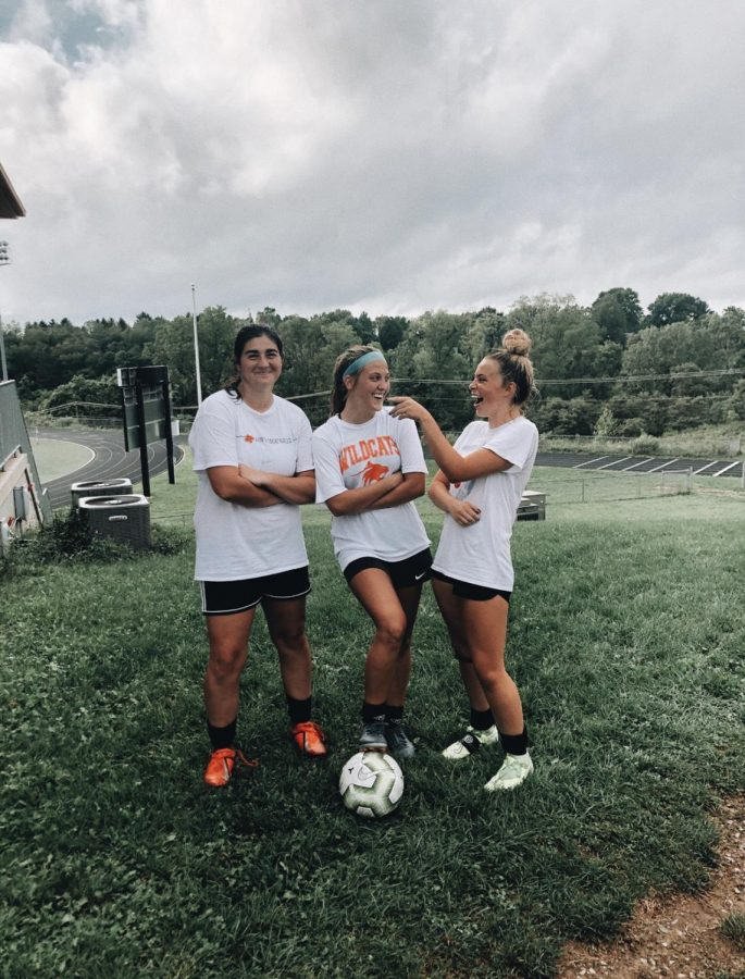 Senior players Sanova Henschel, Chloe Willochell, and Hannah Klimek having fun together after a rainy practice. This practice was one of many used to prepare for important section games.