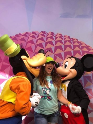 Katie Ulicine poses with two of her favorite Disney characters, Mickey and Goofy.