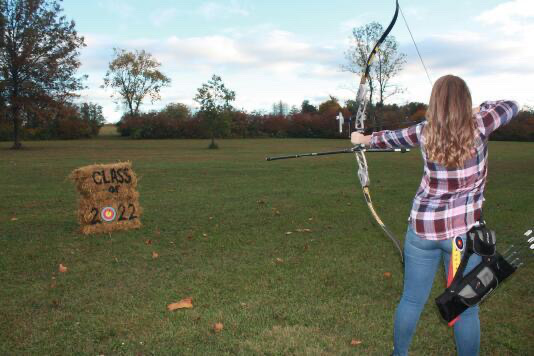 Autumn Pavlik in a shooting stance as she targets the hay bale for her school picture.