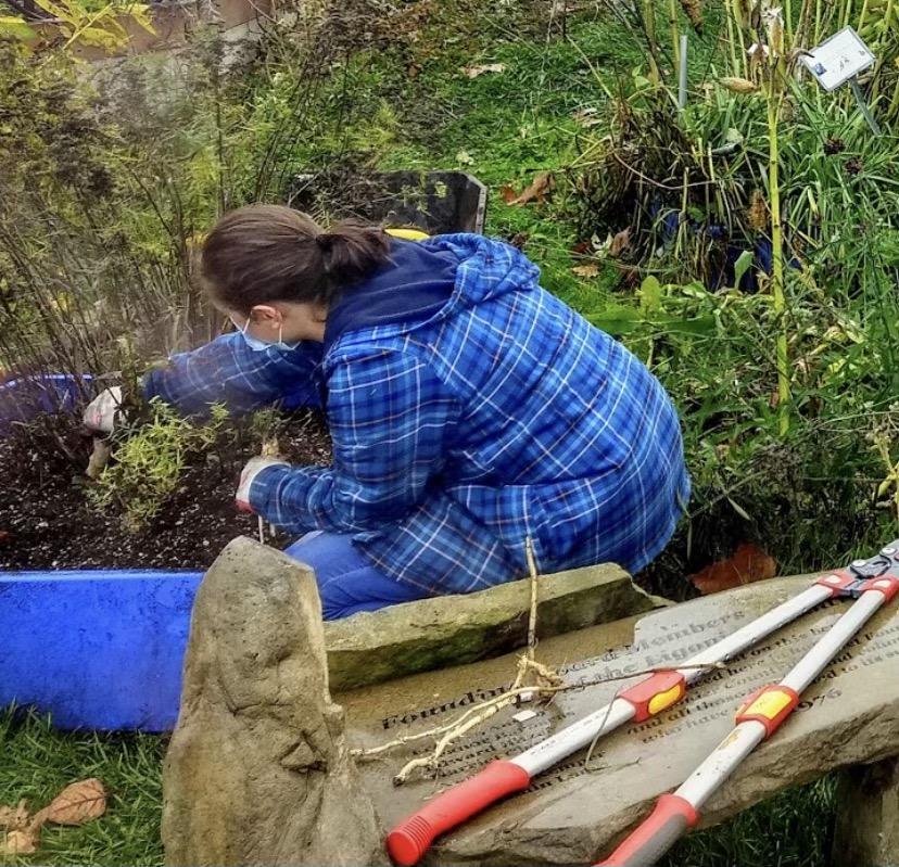 Jordan Desko works hard planting outside in her backyard to make it look beautiful.