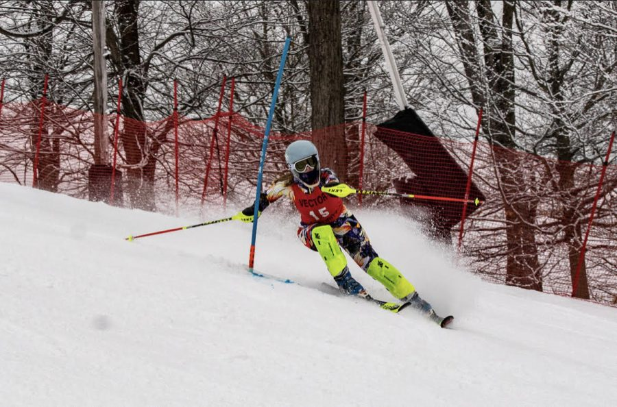 Riley Baughman skis down the twists and turns of the slopes pushing for a win.