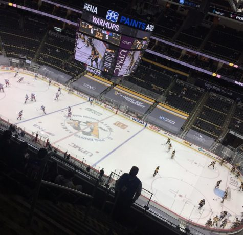 The Pittsburgh Penguins and New York Rangers warming up before the game.