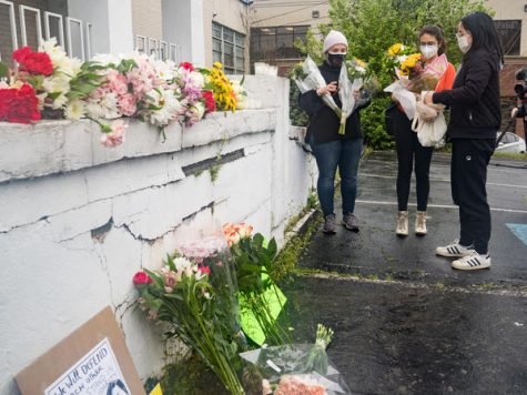 Mourners visit and leave flowers on Wednesday at the site of two shootings at spas across the street from one another in Atlanta. Megan Varner / Getty Images